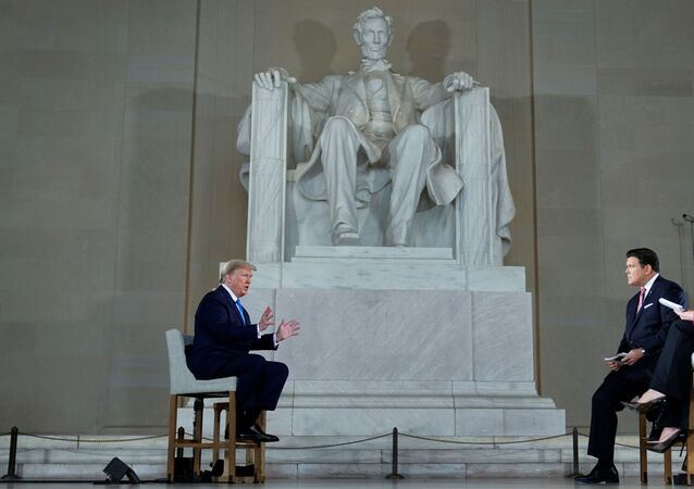 U.S. President Donald Trump is interviewed by hosts hosts Bret Baier and Martha MacCallum during a Fox News Channel virtual town hall called America Together: Returning to Work about the response to the coronavirus disease (COVID-19) pandemic while sitting in front of the statue of former President Abraham Lincoln inside the Lincoln Memorial in Washington, U.S. May 3, 2020