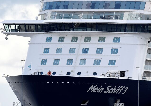 Cruise ship Mein Schiff 3 sits in the harbour with nearly 3000 travel agency TUI staff members quarantined onboard, according to local media, during the coronavirus disease (COVID-19) spread, in Cuxhaven, Germany 2 May 2020.