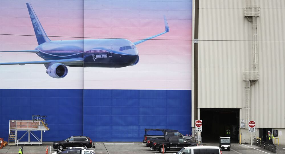 Activity begins to return at the massive Boeing airplane production plant Tuesday, April 21, 2020, in Everett, Wash. Boeing this week is restarting production of commercial airplanes in the Seattle area, putting about 27,000 people back to work after operations were halted because of the coronavirus.
