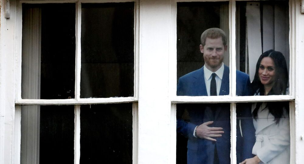 Britain's Prince Harry and Meghan Duchess of Sussex cardboard cut outs are displayed in the window of the Prince Harry pub in Windsor, 10 January 2020