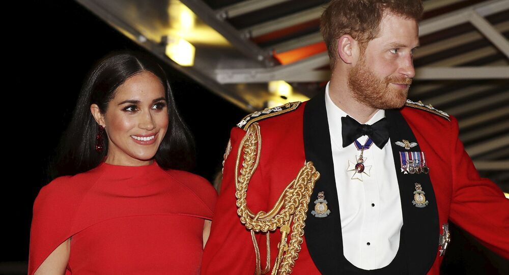 In this Saturday March 7, 2020 file photo, Britain's Prince Harry and Meghan, Duchess of Sussex arrive at the Royal Albert Hall in London. Meghan, Duchess of Sussex has her first post-royal job: narrating a Disney documentary about elephants