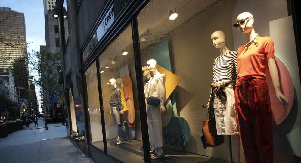 A window display at a J Crew store overlooks a quiet Rockefeller Center, Saturday, May 2, 2020, in New York. On April 30, the company announced it would apply for bankruptcy protection amidst the COVID-19 pandemic