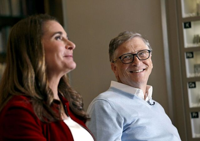 In this Feb. 1, 2019 photo, Bill Gates looks to his wife Melinda as they are interviewed in Kirkland, Wash. The couple, whose foundation has the largest endowment in the world, are pushing back against a new wave of criticism about whether billionaire philanthropy is a force for good. They said they're not fazed by recent blowback against wealthy giving, including viral moments at the World Economic Forum and the shifting political conversation about taxes and socialism.
