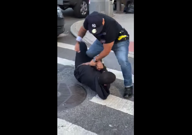 Officer with the New York Police Department is placed on modified duty after cellphone footage emerged showing him attacking a local resident who was approaching the vicinity of an ongoing arrest.