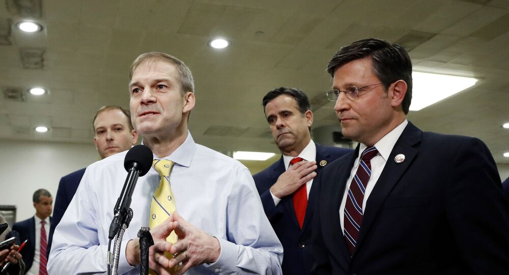 Rep. Jim Jordan, R-Ohio, second from left, talks to reporters while standing with Rep. Lee Zeldin, R-N.Y., left, Rep. John Ratcliffe, R-Texas, second from right, and Rep. Mike Johnson, R-La., R-N.C.,on Capitol Hill in Washington, Friday, Jan. 31, 2020.