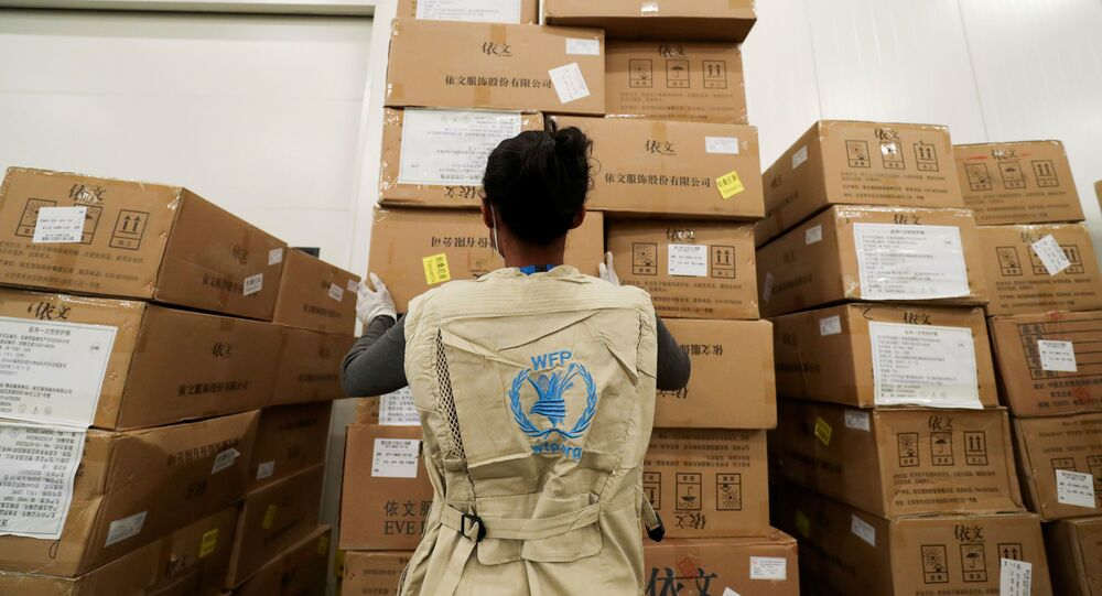 A World Food Program (WFP) worker arranges relief packages at a warehouse designated to the United Nations for humanitarian aid for Africa to combat the outbreak of the coronavirus disease (COVID-19), at the Bole International Airport in Addis Ababa, Ethiopia April 14, 2020.