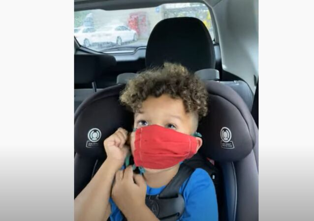 'Fine, I Need Help': Adorable Kiddo Struggles With Face Mask