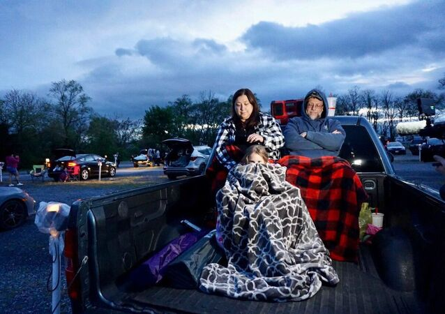 A family attending a drive-in movie theater in the Virginia countryside, U.S.