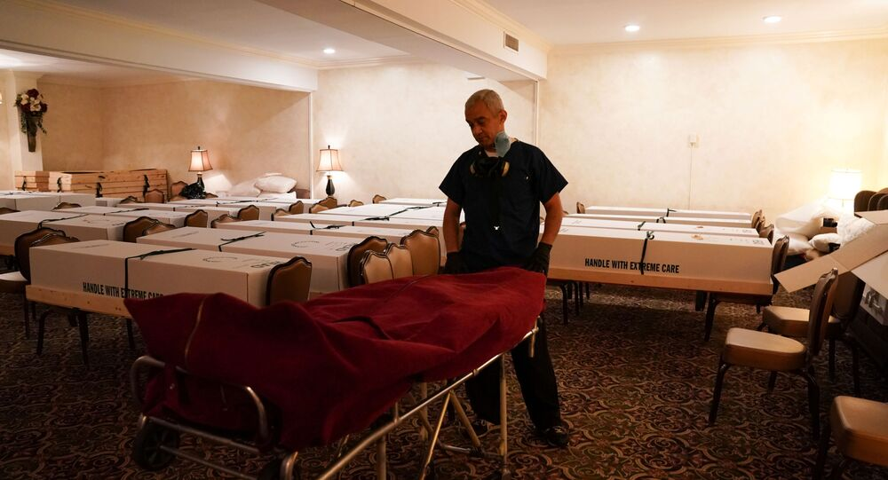 Funeral Director Omar Rodriguez wheels a body from the USNS Comfort into the chapel room at the Gerard J. Neufeld funeral home during the outbreak of the coronavirus disease (COVID-19) in the borough of Queens, New York, U.S., April 26, 2020.