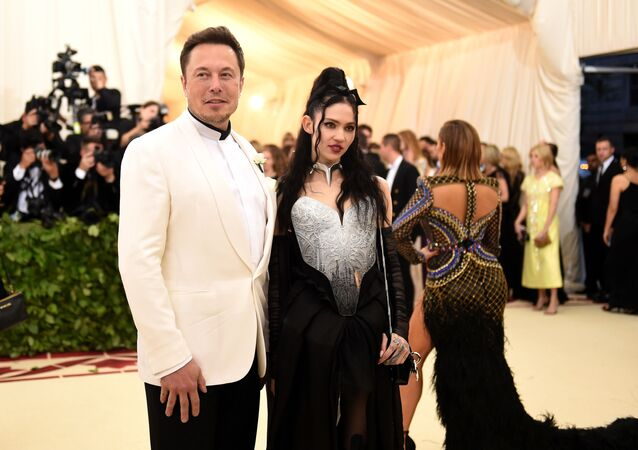 NEW YORK, NY - MAY 07: Elon Musk and Grimes attend the Heavenly Bodies: Fashion & The Catholic Imagination Costume Institute Gala at The Metropolitan Museum of Art on May 7, 2018 in New York City.