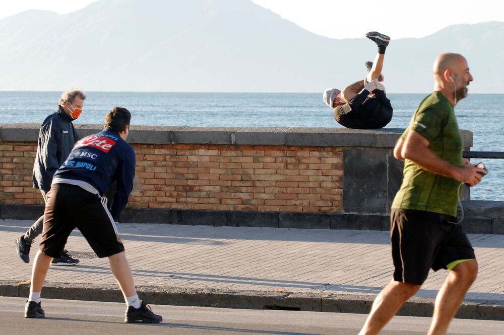 People exercise on the street, as Italy begins a staged end to a nationwide lockdown due to the spread of the coronavirus disease (COVID-19), in Naples, Italy 4 May 2020.