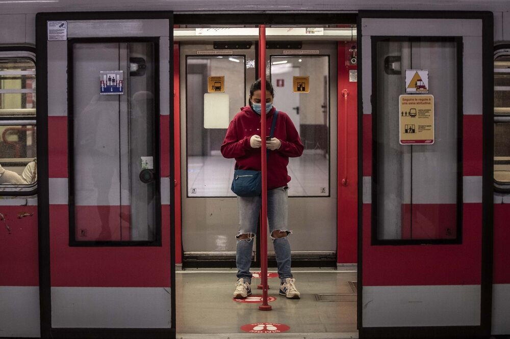 A woman stands in a subway wagon at a stop, in Milan, Italy, Monday, 4 May 2020. Italy began stirring again Monday after a two-month coronavirus shutdown, with 4.4 million Italians able to return to work and restrictions on movement eased in the first European country to lock down in a bid to stem COVID-19 infections.