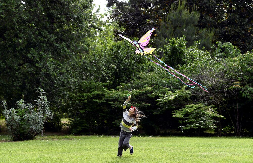 A child plays with a kite at the Sempione Park, after parks reopen as Italy begins a staged end to a nationwide lockdown due to a spread of the coronavirus disease (COVID-19), in Milan, Italy, 4 May 2020.