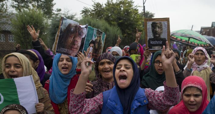 Kashmiris shout slogans during a protest after Friday prayers against the abrogation of article 370, on the outskirts of Srinagar, Indian controlled Kashmir, Friday, Oct. 4, 2019.