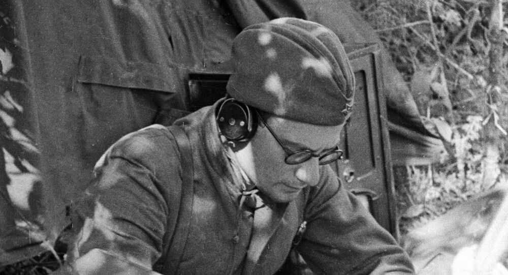 A Soviet radio operator jots down information from the Sovinformbureau, May 1942.