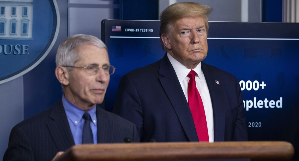 Dr. Anthony Fauci, director of the National Institute of Allergy and Infectious Diseases, about the coronavirus, as President Donald Trump listens, in the James Brady Press Briefing Room of the White House, Friday, April 17, 2020, in Washington
