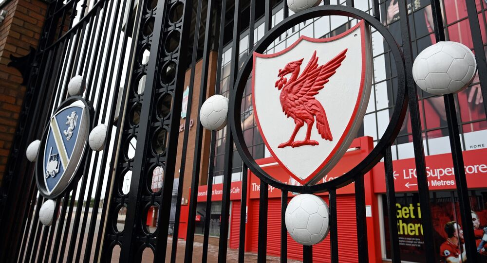 In this file photo taken on 18 April 2020 a locked gate and emblem are seen at Liverpool football club's stadium Anfield in Liverpool, northwest England.
