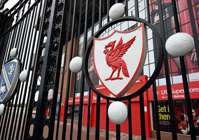 In this file photo taken on April 18, 2020 a locked gate and emblem are seen at Liverpool football club's stadium Anfield in Liverpool, northwest England.