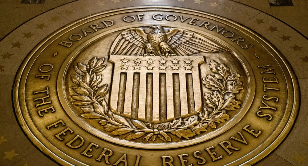 FILE- In this Feb. 5, 2018, file photo, the seal of the Board of Governors of the United States Federal Reserve System is displayed in the ground at the Marriner S. Eccles Federal Reserve Board Building in Washington. Richard Clarida, President Donald Trump's nominee for the No. 2 post at the Federal Reserve, pledged on Tuesday, May 15, to support the Fed's twin goals of stabilizing inflation and maximizing employment while also declaring the importance of the central bank's independence.