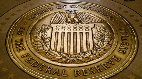 FILE- In this Feb. 5, 2018, file photo, the seal of the Board of Governors of the United States Federal Reserve System is displayed in the ground at the Marriner S. Eccles Federal Reserve Board Building in Washington. Richard Clarida, President Donald Trump's nominee for the No. 2 post at the Federal Reserve, pledged on Tuesday, May 15, to support the Fed's twin goals of stabilizing inflation and maximizing employment while also declaring the importance of the central bank's independence.  - Sputnik International
