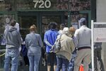 People line up outside the Utah Department of workforce Services Monday, April 13, 2020, in Salt Lake City.