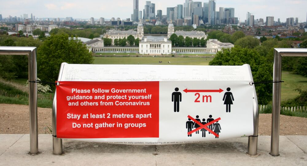 A sign is seen telling people to socially distance in Greenwich Park, following the outbreak of the coronavirus disease (COVID-19), London, Britain, May 4, 2020