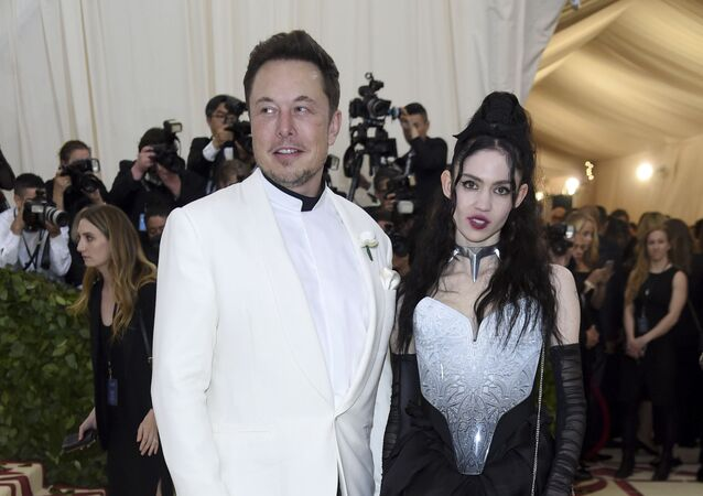 Elon Musk, left and Grimes attends The Metropolitan Museum of Art's Costume Institute benefit gala celebrating the opening of the Heavenly Bodies: Fashion and the Catholic Imagination exhibition on Monday, May 7, 2018, in New York.