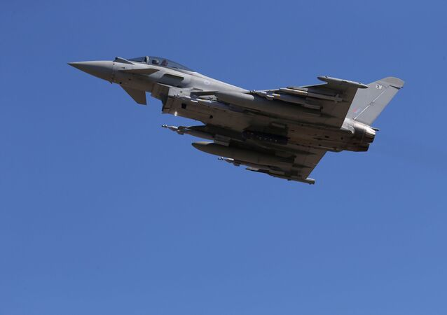 In this Thursday, Sept. 22, 2016, a Typhoon aircraft takes off from RAF, Akrotiri, Cyprus.  British air forces for a mission in Iraq.