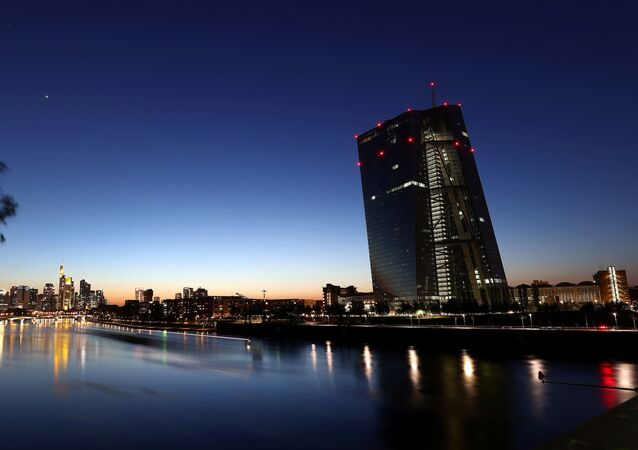The head quarter of the European central bank (ECB,R) is photographed during sunset in Frankfurt, Germany, April 22, 2020, as the spread of the coronavirus disease (COVID-19) continues