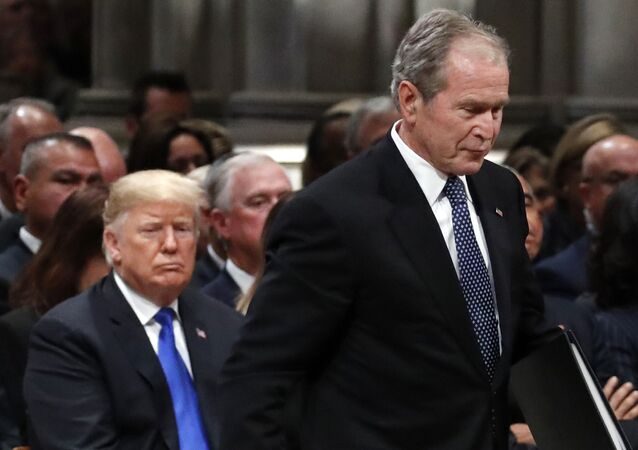 Former President George W. Bush walks past President Donald Trump to speak at the State Funeral for his father, former President George H.W. Bush, at the State Funeral at the National Cathedral, 5 December 2018, in Washington