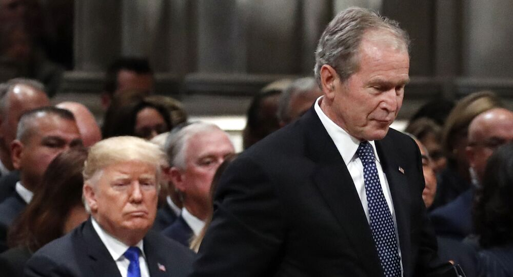 Former President George W. Bush walks past President Donald Trump to speak at the State Funeral for his father, former President George H.W. Bush, at the State Funeral at the National Cathedral, Wednesday, Dec. 5, 2018, in Washington