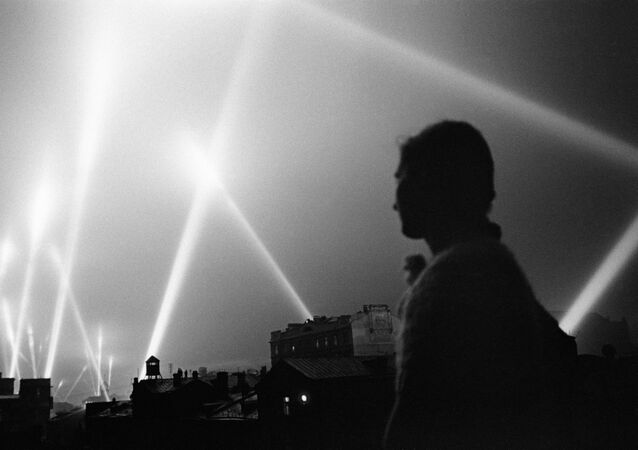 The rays of the searchlights of the air defense troops illuminate the sky of Moscow. Moscow, June 1941.