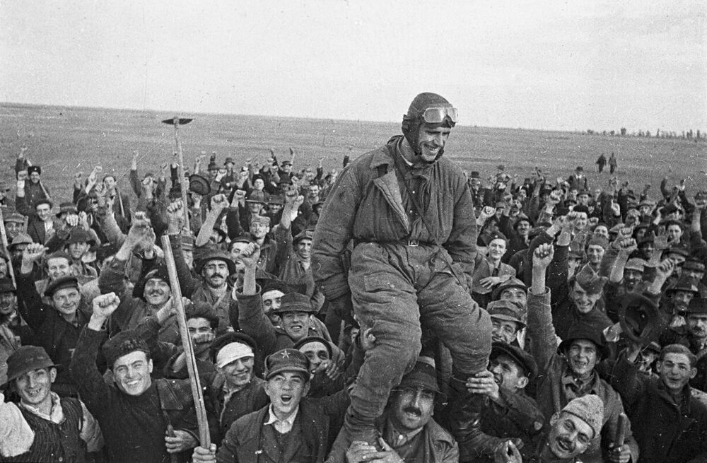 Residents of the village of Omolitsa welcome the Soviet pilot Semen Boyko, who flew first to Yugoslav land.