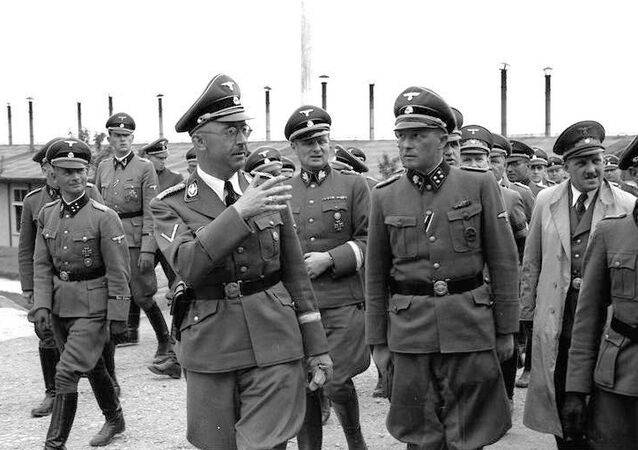 Heinrich Himmler visiting Mauthausen in June 1941. Himmler is talking to Franz Ziereis, camp commandant, with Karl Wolff on the left and August Eigruber on the right.