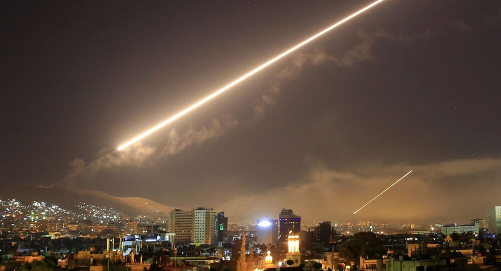 FILE - In this April 14, 2018 file photo, Damascus skies erupt with surface to air missile fire as the U.S. launches an attack on Syria targeting different parts of the Syrian capital Damascus, Syria