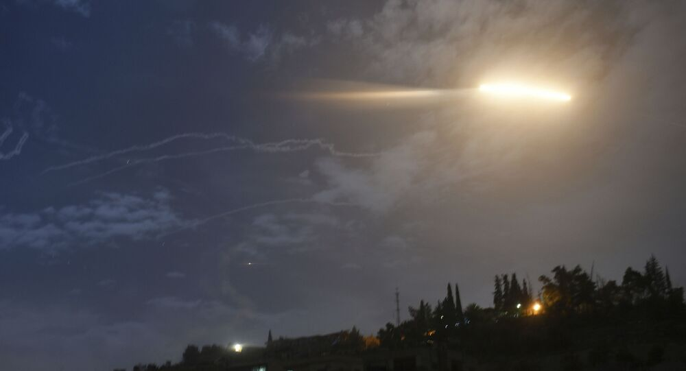 In this photo released by the Syrian official news agency SANA, shows missiles flying into the sky near international airport, in Damascus, Syria, Monday, Jan. 21, 2019