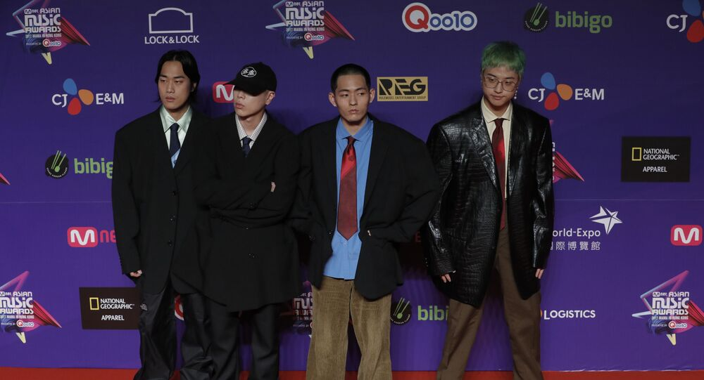Members of South Korean music band Hyukoh pose for photos on the red carpet of the Mnet Asian Music Awards (MAMA) in Hong Kong, Friday, Dec. 1, 2017
