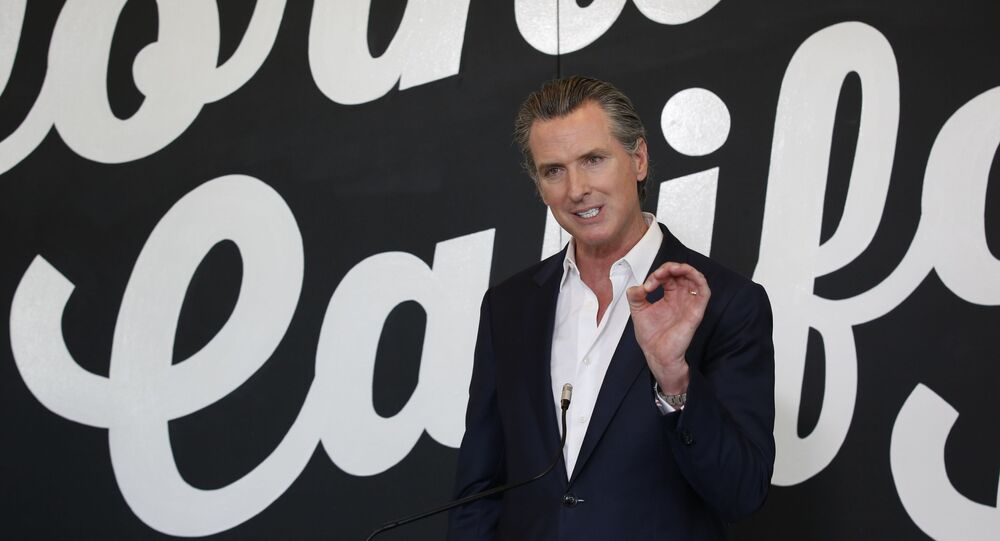 Gov. Gavin Newsom discusses his plan for the gradual reopening of California businesses during a news conference at the Display California store in Sacramento, Calif., Tuesday, May 5, 2020