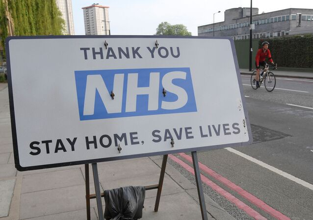 A sign thanking the NHS is seen in London