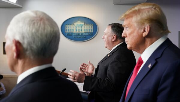 U.S. Vice President Mike Pence and President Donald Trump listen as Secretary of State Mike Pompeo addresses the daily coronavirus task force briefing at the White House in Washington, U.S., April 8, 2020 - Sputnik International