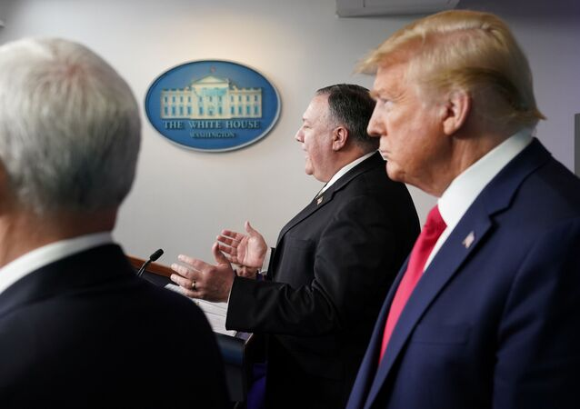 U.S. Vice President Mike Pence and President Donald Trump listen as Secretary of State Mike Pompeo addresses the daily coronavirus task force briefing at the White House in Washington, U.S., April 8, 2020