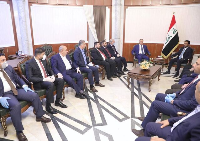 The speaker of Iraq's parliament Mohammed al-Halbousi meets with Iraqi Prime Minister-designate Mustafa al-Kadhimi before the vote on the new government at the parliament headquarters in Baghdad, Iraq, May 6, 2020.
