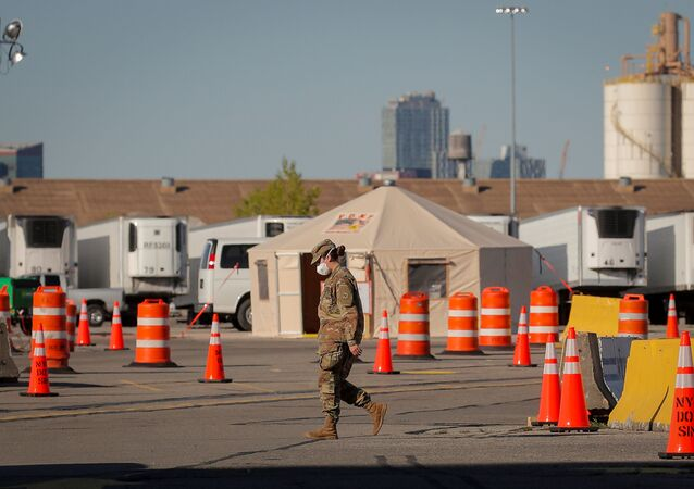 A U.S. Army National Guard soldier walks outside a temporary morgue, during the outbreak of the coronavirus disease (COVID-19) in the Brooklyn borough of New York City, U.S., May 5, 2020