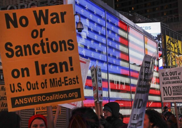 Protesters gather in Times Square Wednesday, Jan. 8, 2020, in New York. The U.S. and Iran stepped back from the brink of possible war Wednesday, as President Donald Trump indicated he would not respond militarily after no one was harmed in Iran's missile strike on two Iraqi bases housing U.S. troops.
