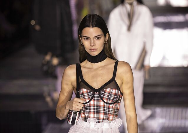 Model Kendall Jenner wears a creation by designer Burberry at the Autumn/Winter 2020 fashion week runway show in London, Monday, Feb. 17, 2020.