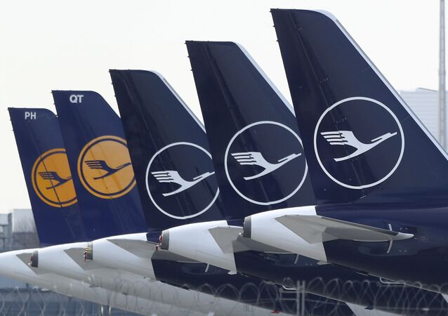 German Lufthansa planes sit parked in a line at the airport in Munich, Germany, Thursday, March 26, 2020