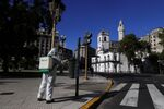 A worker disinfects Plaza de Mayo after Argentina's President Alberto Fernandez announced a mandatory quarantine as a measure to curb the spread of coronavirus disease (COVID-19), in Buenos Aires, Argentina March 20, 2020