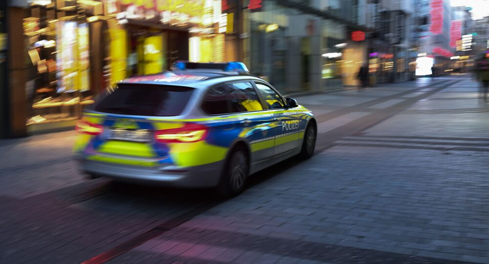 A police car drives through the pedestrian zone in Cologne, western Germany, on March 23, 2020 during the novel coronavirus COVID-19 pandemeic