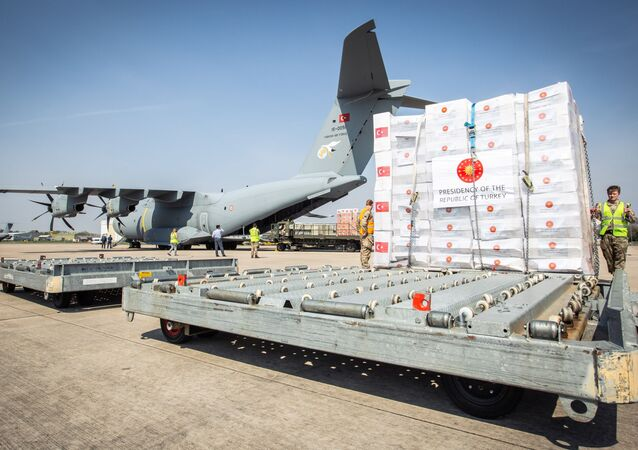 Crucial supplies of personal protective equipment (PPE) for medical staff are delivered from Turkey into a Royal Air Force base for distribution around the country, amid the coronavirus disease (COVID-19) outbreak, in Carterton, Britain, April 10, 2020