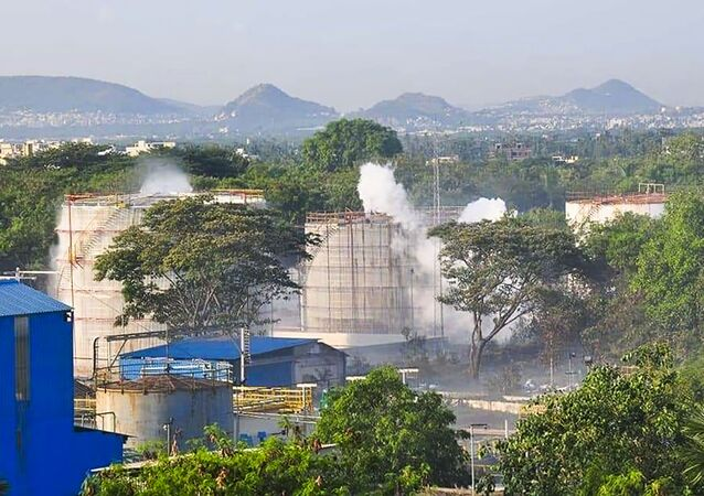Smokes rise from an LG Polymers plant following a gas leak incident in Visakhapatnam on May 7, 2020